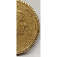 AUSTRALIA . UNDATED . ONE DOLLAR COIN . ERROR . OIL FILLED ON OBVERSE . MISSING LEGEND